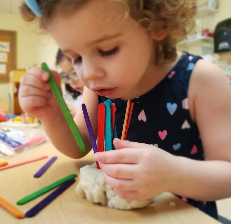 small child making art